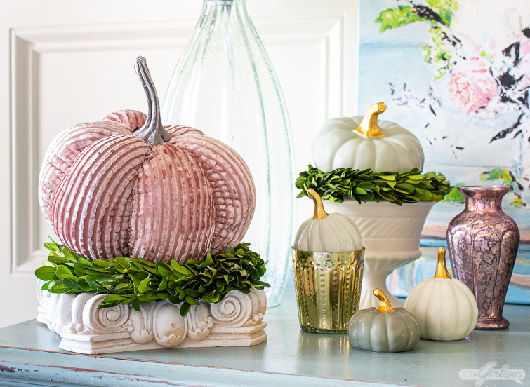pink velvet pumpkin on a plaster stand for non traditional fall foyer decorating ideas