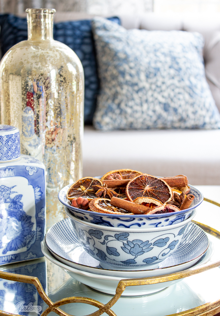 chinoiserie bowl of Christmas potpourri sitting on a mirrored tray in a living room