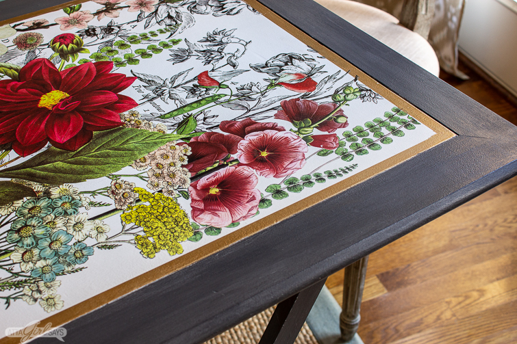 closeup of a folding game table with a floral tabletop