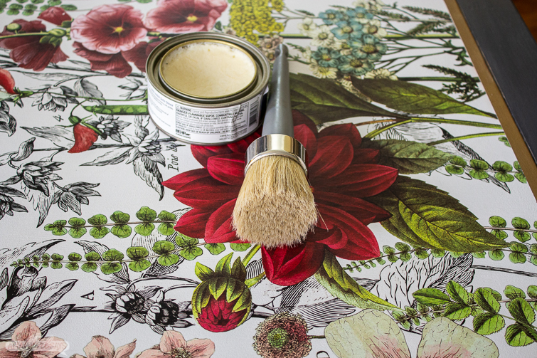 using wax to seal a tabletop embellished with a decorative floral transfer