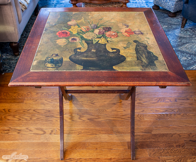 folding wooden game table with a floral inset top