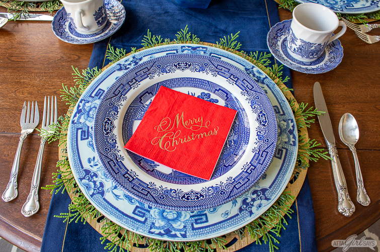 red Christmas napkin on a Blue Willow plate