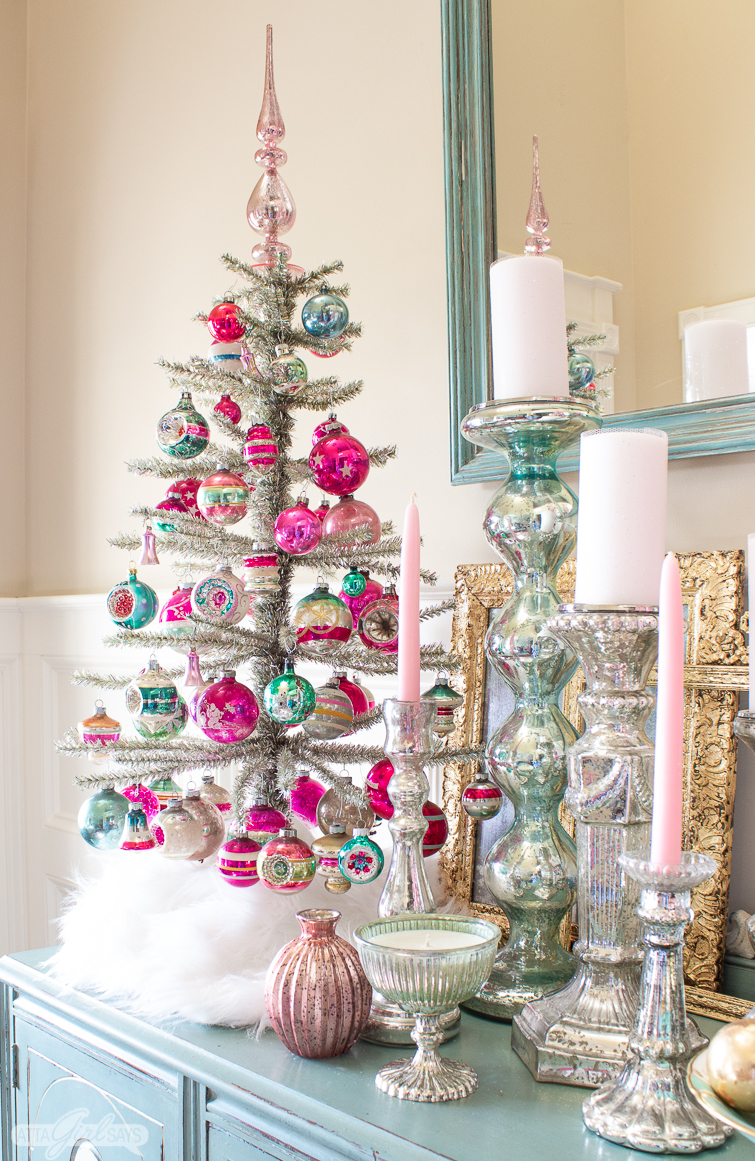 vintage pink and green Shiny brite ornaments on a silver tinsel tree with mercury glass candlesticks