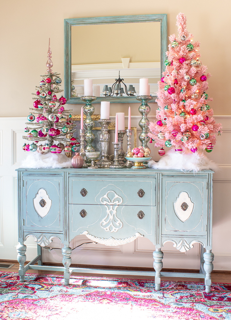 vintage shiny brite ornaments on a tinsel tree and a pink Christmas tree in an airy foyer