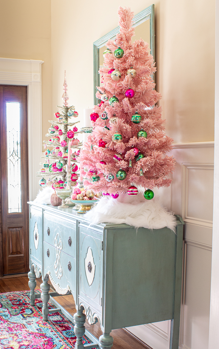 vintage glass ornaments hanging on a pink Christmas tree and a silver tinsel tree