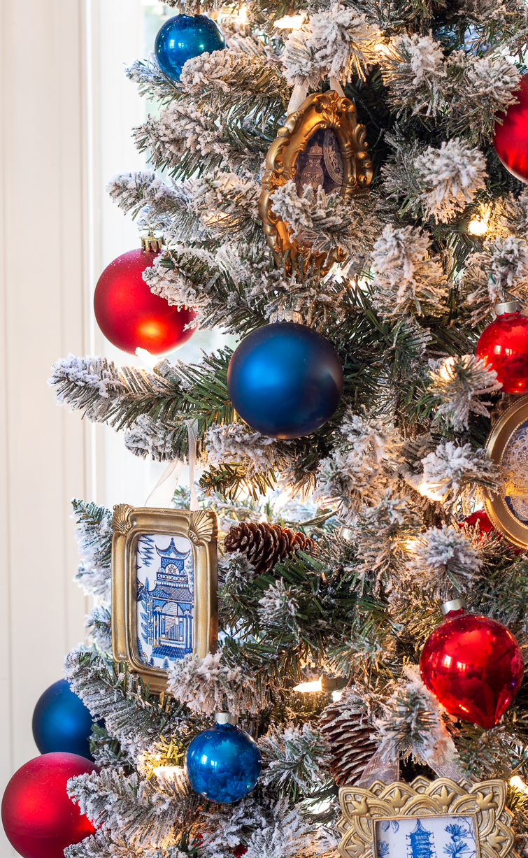 flocked Christmas tree decorated with red, blue and chinoiserie Christmas ornaments