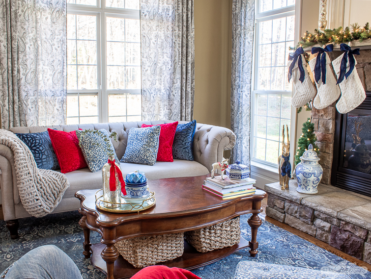 gray sofa with blue and red velvet pillows