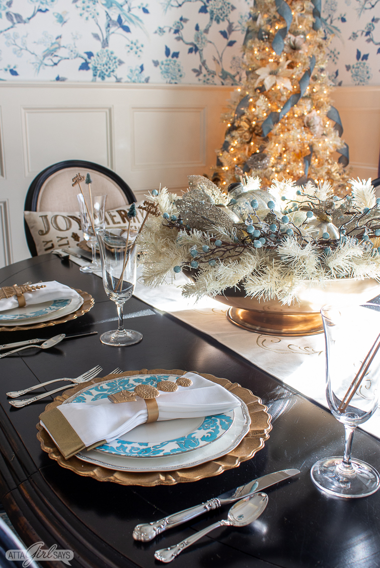 christmas tablescape with aqua and gold with a large centerpiece in a gold bowl