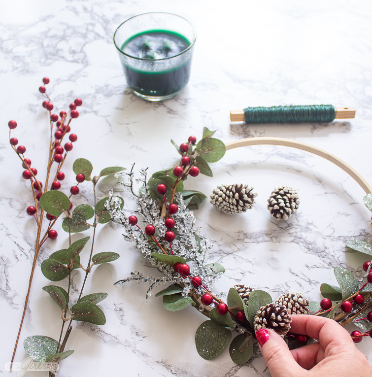 making an embroidery hoop wreath with eucalyptus and pinecones