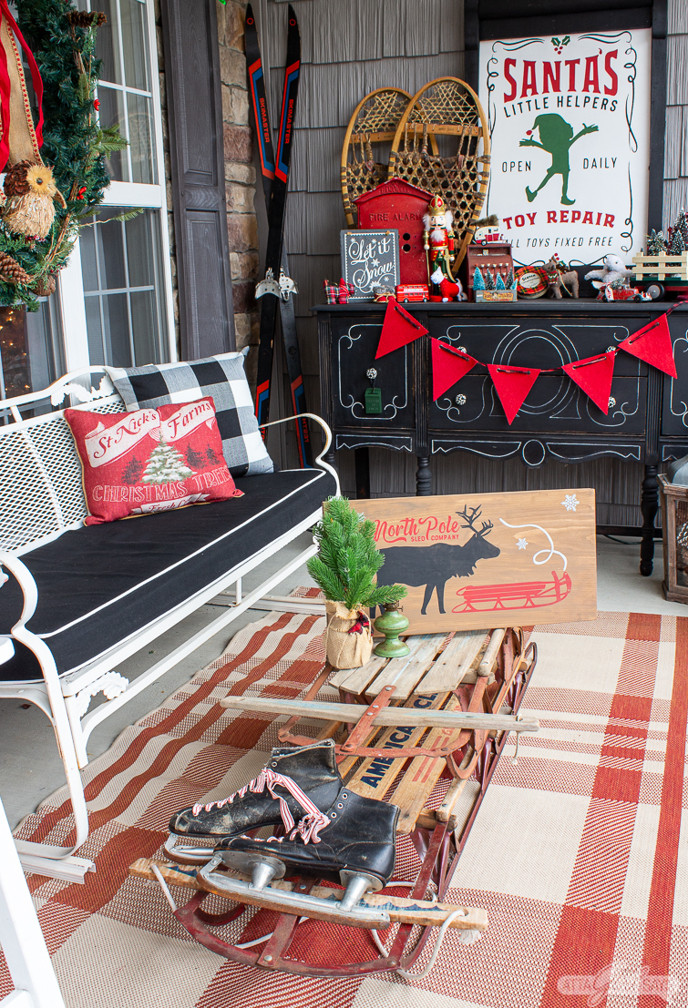 vintage glider bench and front porch Christmas decorations