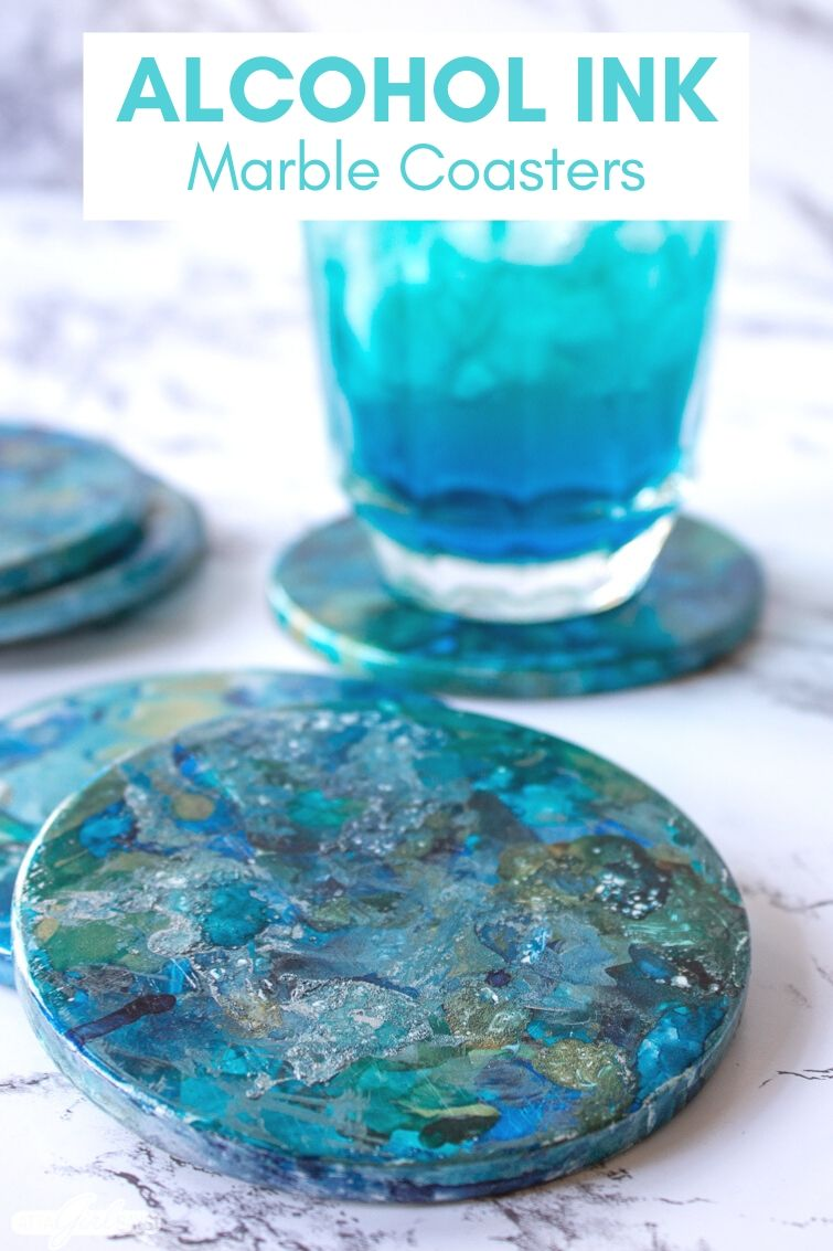 marbled alcohol ink coasters with a blue cocktail