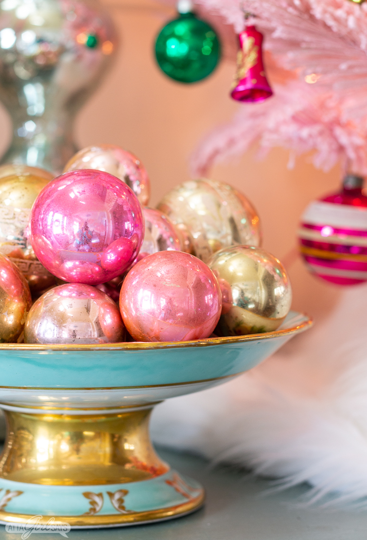 pink and gold vintage glass Christmas ornaments in an antique compote