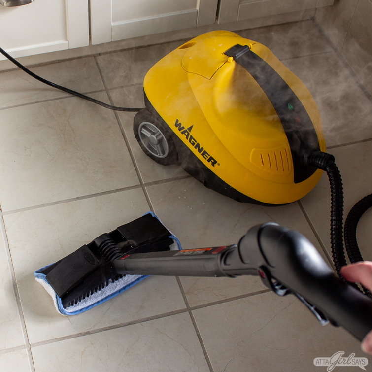 steam cleaning a bathroom floor