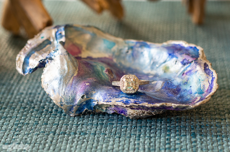 diamond ring in a blue marble oyster shell