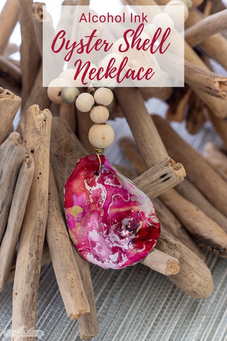 pink and red alcohol ink oyster shell pendant necklace